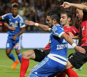 Remy CABELLA / Lars JACOBSEN - 28.08.2015 - Guingamp / Marseille - 4eme journee de Ligue 1 Photo : Vincent Michel / Icon Sport