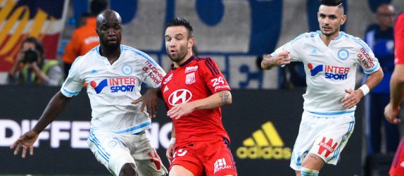 Lassana DIARRA / Mathieu VALBUENA - 20.09.2015 - Marseille / Lyon - 6eme journee de Ligue 1 Photo : Gaston Petrelli / Icon Sport