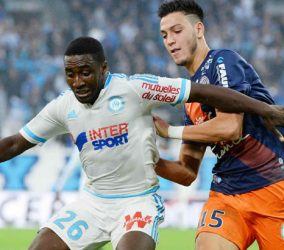 Brice DJA DJEDJE / Ramy BENSEBAINI - 06.12.2015 - Marseille / Montpellier - 17e journee Ligue 1 Photo : Gaston Petrelli / Icon Sport