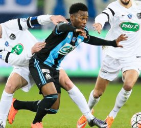 (L-R) Matthias Jouan of Granville, Georges-Kevin Nkoudou of Marseille and Antoine Peron of Granville during the French Cup game between US Granville V Olympique de Marseille at Stade Michel D'Ornano on March 3, 2016 in Caen, France.