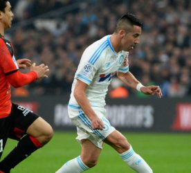 Benjamin ANDRE of Rennes  and Mauricio ISLA of Marseille during the French Ligue 1 match between Olympique de Marseille v Stade Rennes at Stade Velodrome on March 18, 2016 in Marseille, France.