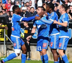 Michy Batshuayi celebrates with team mates during the French Ligue 1 match between Angers SCO and Olympique de Marseille on May 1, 2016 in Angers, France. (Photo by Philippe Le Brech/Icon Sport)