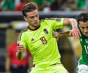 Venezuela's Christian Santos (l) battles for the ball with Mexico's Andres Guardado (r). --------------------   Football - Copa America 2016 Group Stage Group C Mexico v Venezuela NRG Stadium, Houston, United States 13 June 2016 Photo : BPI / Icon Sport