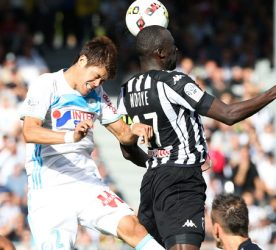 Cheick Ndoye of Angers and Hiroki Sakai of Marseille during the ligue 1 match between Angers SCO and Olympique de Marseille on October 2, 2016 in Angers, France. (Photo Icon Sport)