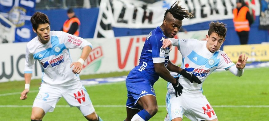 Hiroki Sakai of Marseille, Allan St Maximin of Bastia and Maxime Lopez of Marseille during the Ligue 1 match between SC Bastia and Olympique de Marseille at Stade Armand Cesari on December 21, 2016 in Bastia, France. (Photo by Dume/Icon Sport)